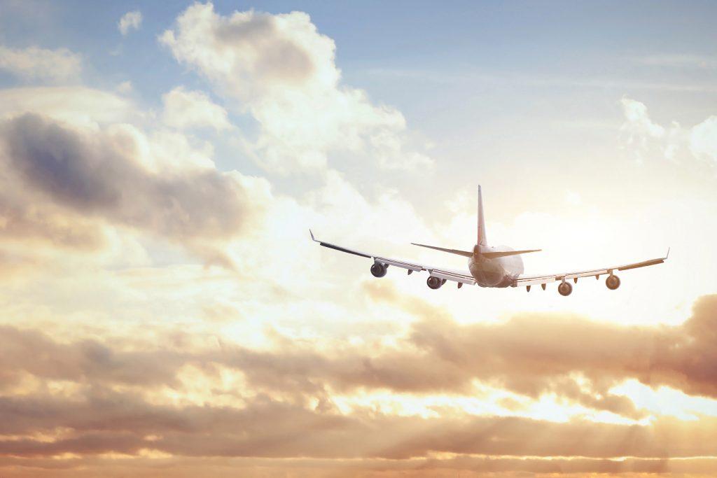 airplane flying in the sky expatriate overseas